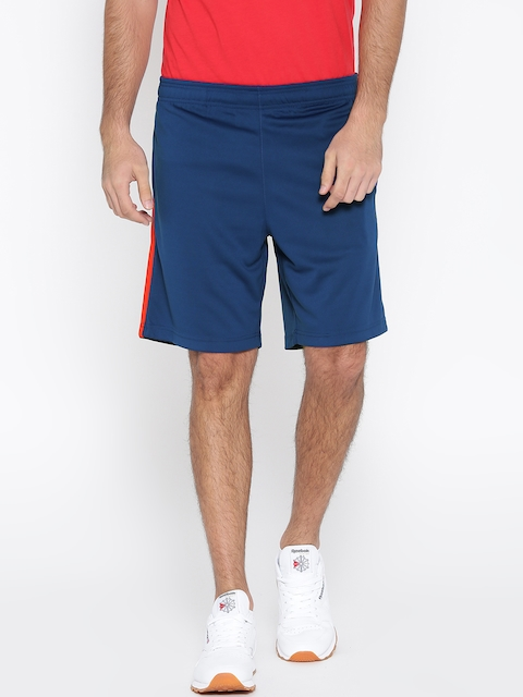 Reebok Men Blue Core Poly Knit Solid Regular Fit Sports Shorts  available at myntra for Rs.629