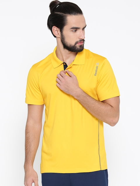 Reebok Men Yellow Core Solid Polo Collar T-shirt  available at myntra for Rs.599