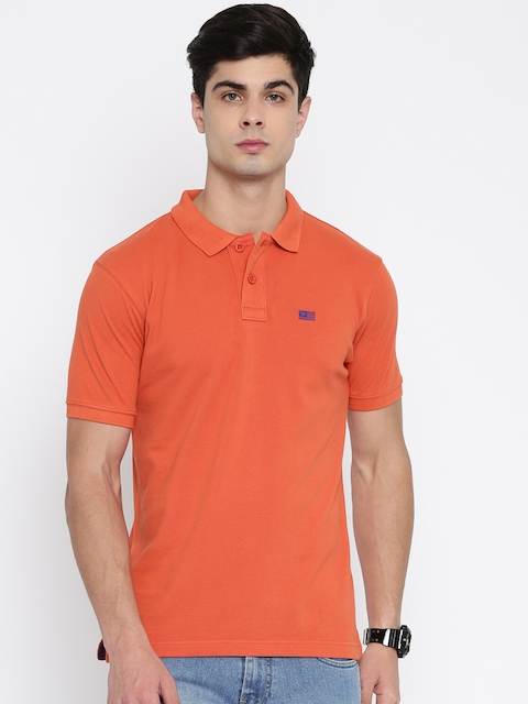 Wrangler Men Coral Orange Solid Polo Collar T-shirt  available at myntra for Rs.837