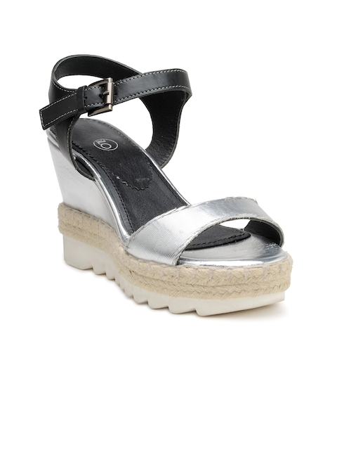 iLO Women Black & Silver-Toned Colourblocked Wedges  available at myntra for Rs.1079