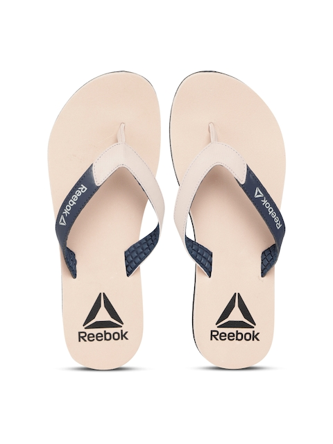 4eb725309 Reebok Women Peach-Coloured   Navy Blue Core Solid Thong Flip-Flops Image